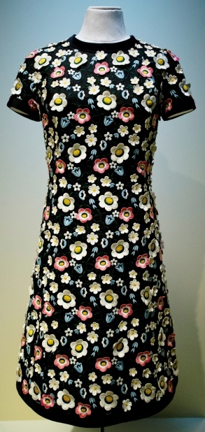 This is dress Princess Grace wore to EXPO 67 designed by the Nice fashion house Marie-Therese for Grace's visit to Expo 67 in Montreal for a ceremony opening Monaco's pavilion. The designer started with the typical little black dress and then added 3D-embroidered flowers in many colours. Perhaps even Princess Grace needed some Technicolour to stand out amid all the splendours of Expo 67 ! On display in Montreal.