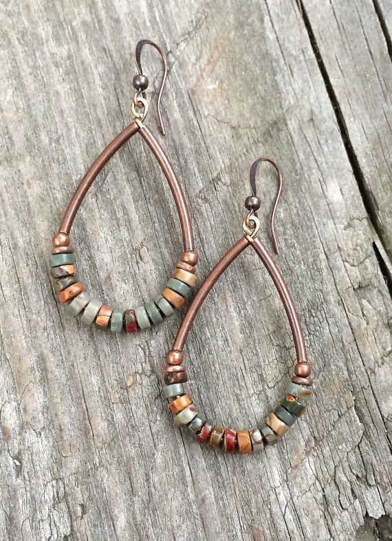 Earth toned red creek Jasper earrings with antiqued copper accents. These stones vary in subtle, earthy tones colors such as greens, mustard yellow, reds, oranges. Approx 2 in length and very light weight.