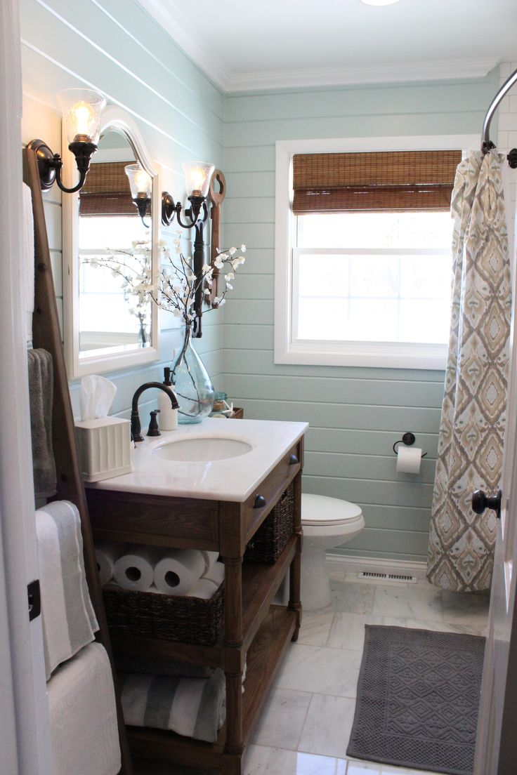 Pretty  airy and tranquil guest bathroom renovation featuring white marble floors and wood paneled walls painted in Benjamin Moore Palladian Blue  via 12. 10  images about Main Bathroom Ideas on Pinterest   Polished