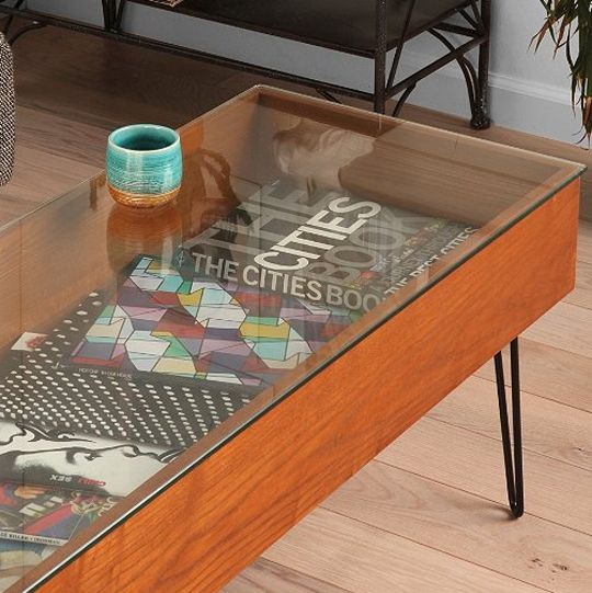 """the Gallery Coffee Table lets you show off beautiful """"coffee table books"""" without losing a usable surface. At Urban Outfitters"""