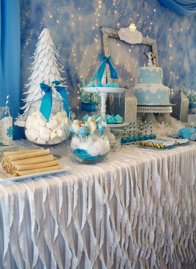 Winter Party Tablecloth Idea – Disney's Frozen is wildly popular with the pre-teen crowd. This pretty table from Kara's Party Ideas uses ruffles and crepe paper to simulate a winter landscape.