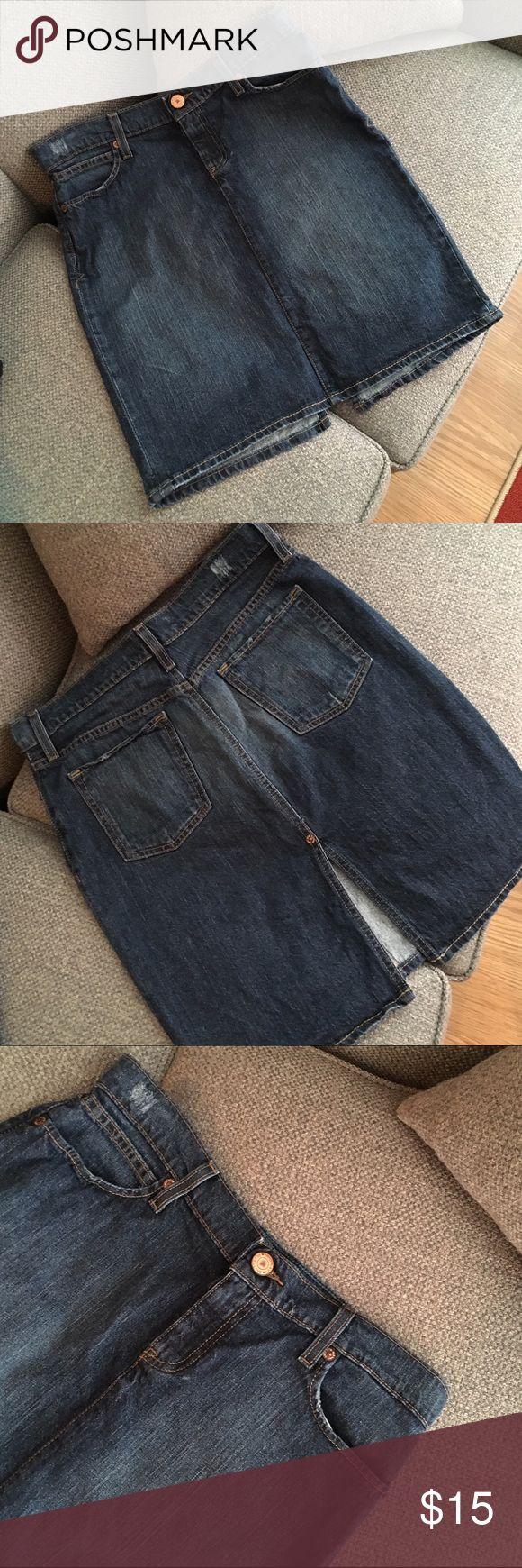 Jean Skirt Old Navy jean skirt. Size 8. Distressed dark denim/details. Back slit. 99% cotton/1% Lycra. Very good condition. Old Navy Skirts