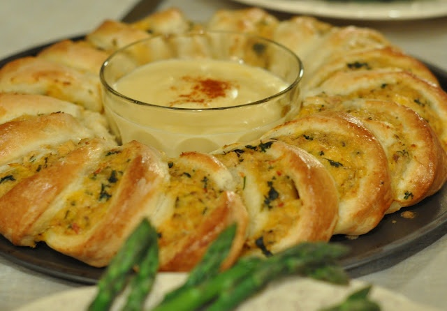 Salmon-filled pastry with optional cheese sauce.
