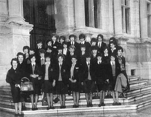 St Augustines Secondary School French Trip 1963   Back Row: Sandra ?; No name. No name. Sandra Bonacorci. No name. French Teacher`s sister.  3rd Row: No name Marjory Brown No name No name French Teacher (Christine, I think)  2nd Row: Rosalind Reilly. Hazel Bradley. Maureen Jack. Angela Morgan. No name. Vicky Storrie. Joyce Moran. No name. No name. French Guide.  Front Row: Teacher?; Miss Kelly (Domestic Science) Ann Magill. Anne Casey. Anne McQuade. Helen?; Phyllis Breen. Carol Donnell. No…