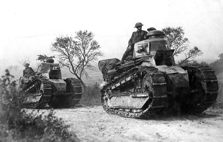 American troops aboard French-built Renault FT-17 tanks head for the front line in the Forest of Argonne, France, on September 26, 1918.