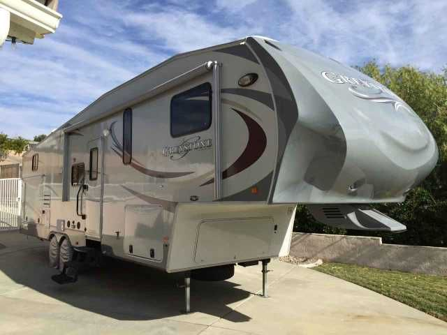 2012 Used Heartland Greystone 33CK Fifth Wheel in California CA.Recreational Vehicle, rv, 2012 Heartland Greystone 33CK, 2012 Heartland Greystone Model 33CK, (38' in total length) Purchased new from dealership in 2012. This is a bunkhouse model, Sleeps 9, and in very clean and good condition. Outdoor kitchen with Dometic refrigerator outside, sink and BBQ propane line hook up. Rear bunk house sleeps 4 and has a TV mounted, couch and air bed in couch. Kitchen is equipped with a 3 burner…