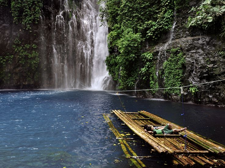 Swimmers laze on a bamboo raft tethered at Tinago Falls in Iligan on the Philippine island of Mindanao. Mount Apo is the highest point on the island, the second largest in the Philippine chain. Photograph by Chris Stowers, Panos Pictures, May 4, 2014
