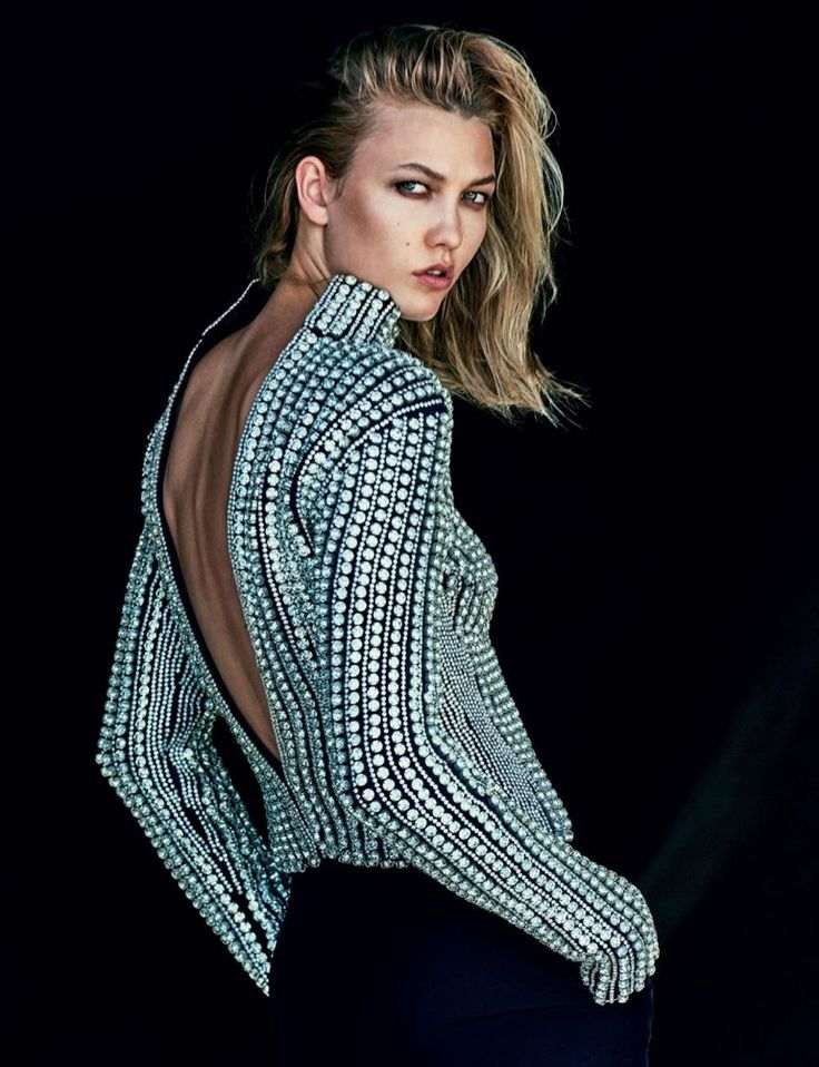 Karlie Kloss shows her back in embellished top