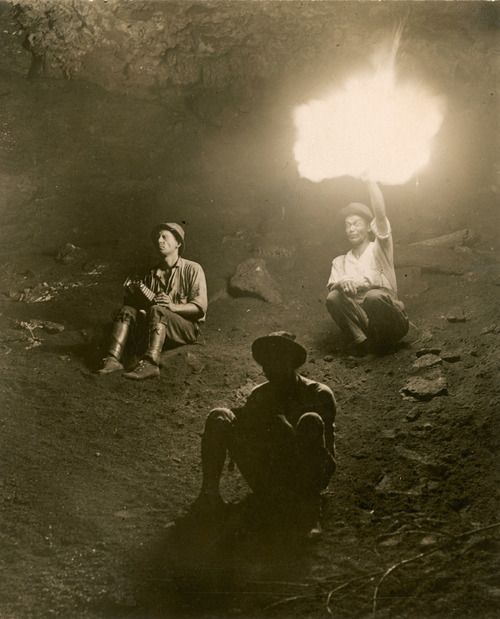 Three scientists inside a fire-lit bat cave, Panama (August 1915; ph. George Shiras, National Geographic)