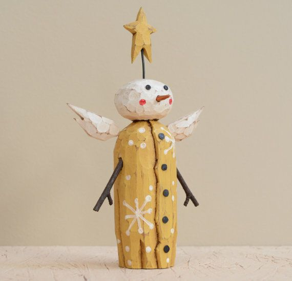 This cute little Snow Angel stands 6 1/2 tall and is hand carved from 1 1/2 thick basswood. It has natural twig arms, metal tack buttons and eyes