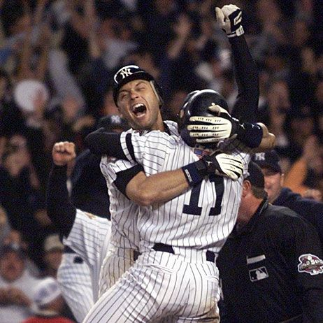 Chuck Knoblauch (11) leaps into the arms of Derek Jeter after Knoblauch scored the winning run in the 12th inning, defeating the Arizona Diamondbacks 3-2 to take Game 5 of the World Series on Nov. 1, 2001 at Yankee Stadium. (Rusty Kennedy/AP)