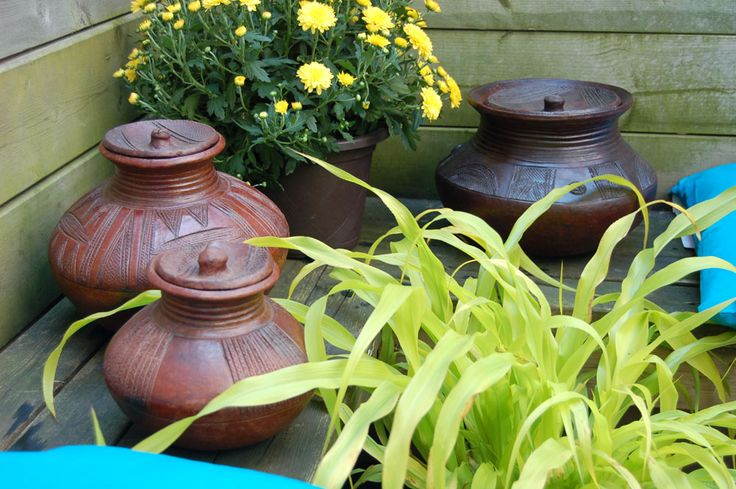 Deck out your summer... rustic, natural, earthy African pottery. Available now in #Toronto... afrimod.com #Summer #decks #African #pottery #garden #patio
