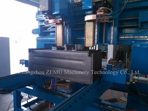 Spot welding machine for corrugated fin with embossing