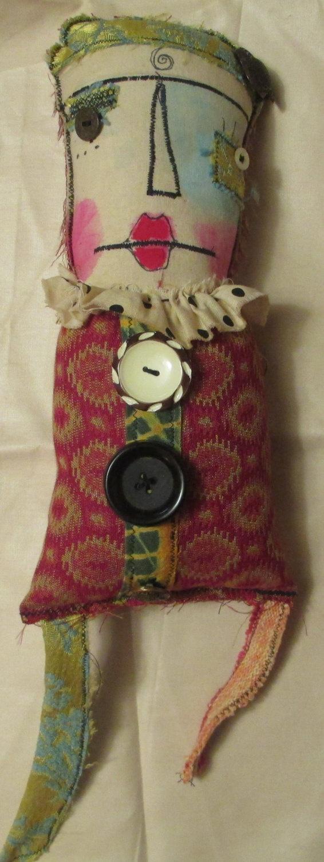 Wanda.17 x 5 fabric rag doll with wool hair including legs. Not a toy.. $27.00, via Etsy.