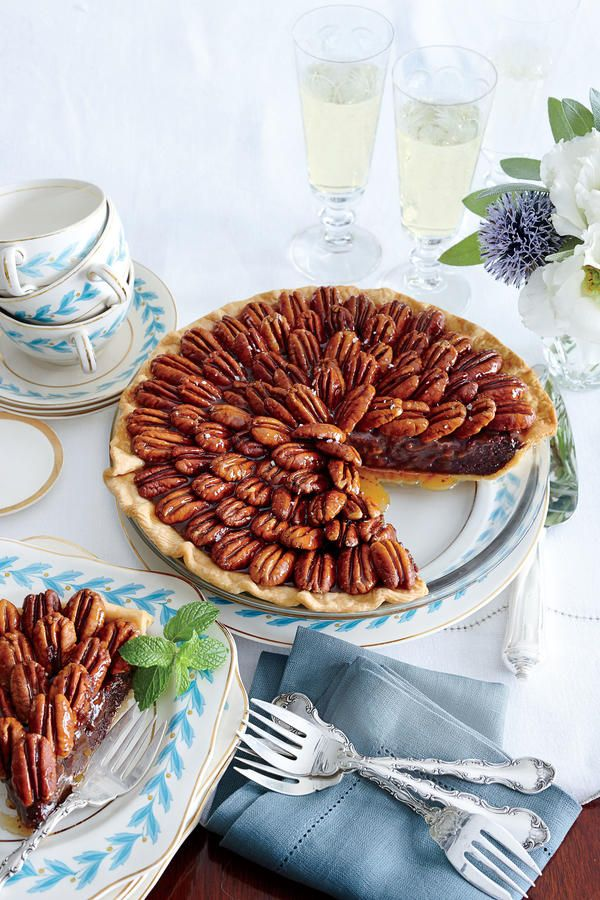 Salted Caramel-Chocolate Pecan Pie - 37 Caramel Dessert Recipes - Southernliving. Recipe:Salted Caramel-Chocolate Pecan Pie  Let these Thanksgiving pies dazzle on your dessert table this year. From to-die-for pumpkin cheesecake to tried-and-true apple—guests won't be able to resist these Thanksgiving sweets.  A cross between a fudge pie and pecan pie, this is all the more stunning if you arrange the pecans from the center in a spiral pattern.  Cooking Video:Salted Caramel-Chocolate Pecan…