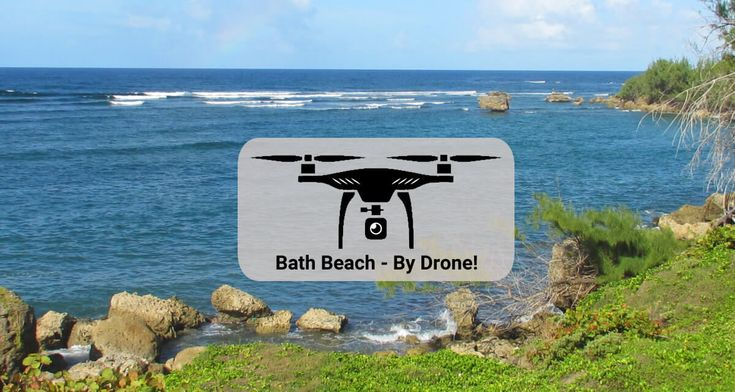 Soaring over the ocean waters and ruggedly beautiful shore at Bath Beach, on the east coast of Barbados....