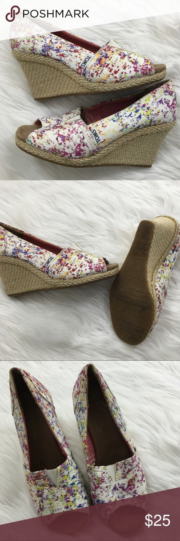 Toms Wedges Super cute and gently worn toms wedges. The colorful fabric makes it perfect to wear with many different things! TOMS Shoes Wedges