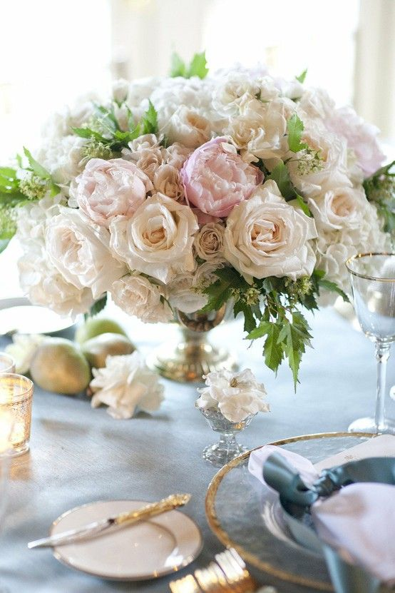 compact rose centerpiece design in a footed compote bowl