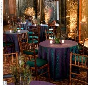 Decorate your reception space with rich colored tablecloths that make your guests feel like they have just entered a peacock wonderland.