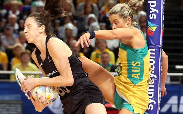 The Silver Ferns Baily Mes grapples with Australia's Julie Corletto. New Zealand's Netball World Cup dream is over after the Silver Ferns were beaten by Australia 58-55 in the final at Sydney.