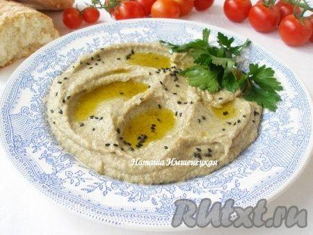 При подаче полить бабагануш оливковым маслом, посыпать черным кунжутом, зеленью петрушки или кинзы.http://rutxt.ru/node/4270
