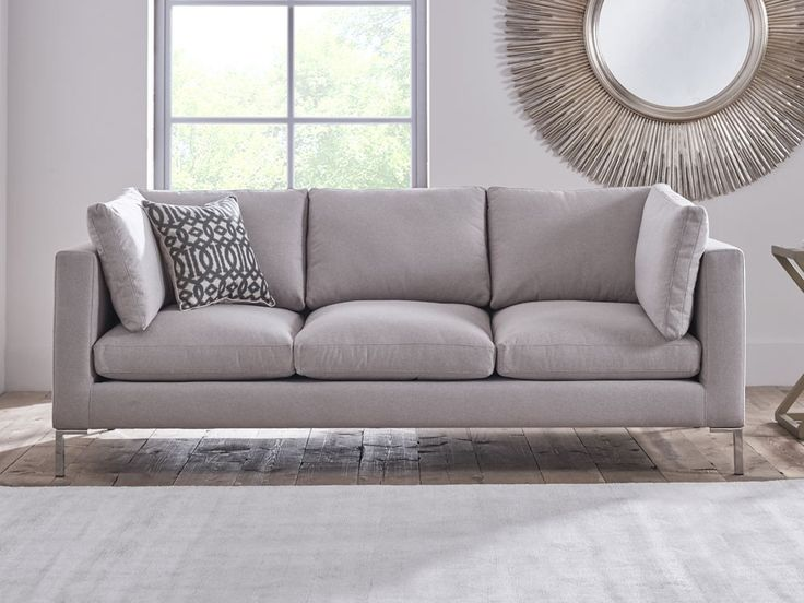 Claudio Sofa - Cushioned armrests and metallic sleigh legs showcase the attention to detail, style and comfort that is shown in this sofa - by www.livingitup.co.uk