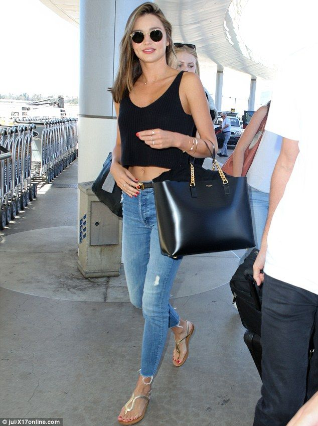 Showing off: A peak of Miranda's taut tummy could be seen as she wore a black crop top alo...