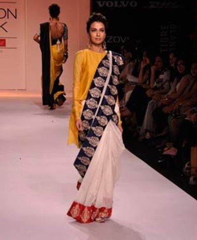 Instead of a blingy blouse, how about wearing  it with a silhouette. It's trendy modern & classy. #Sari #Style
