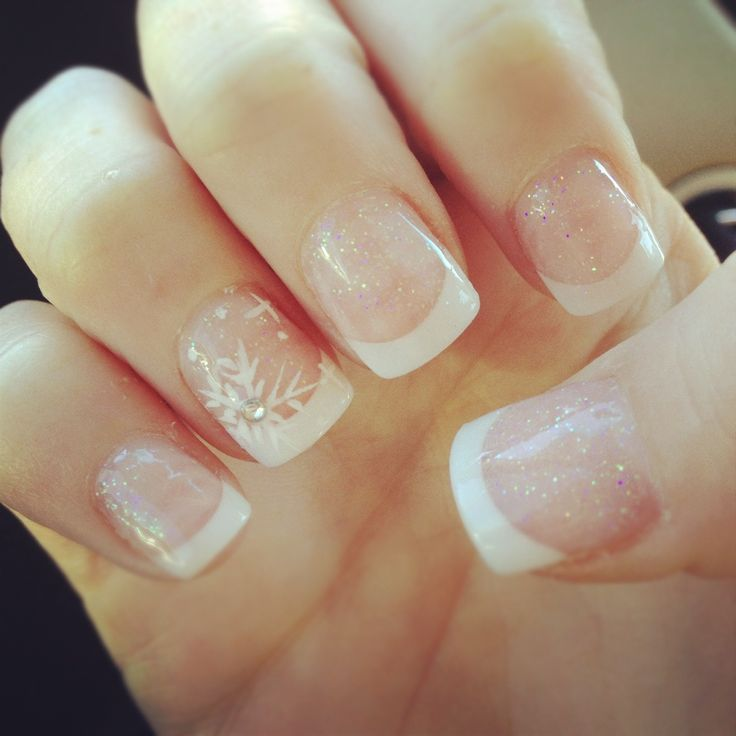 Snowflake nails. these are cute. If it was summer or spring you could put a bold color flower in place of the snowflake.