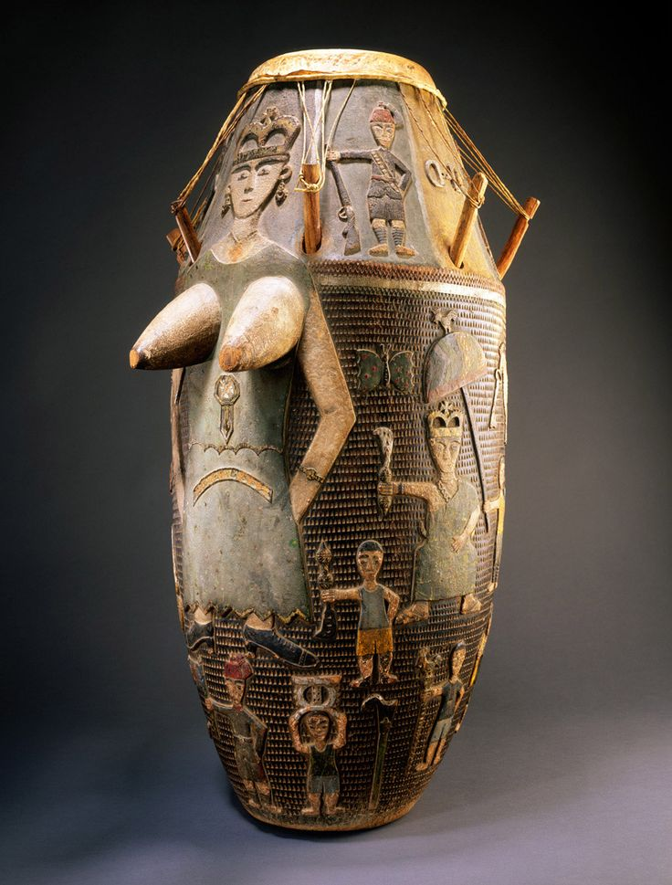 "This instrument was once the ""master""/""mother"" drum of a Fante popular band. Each group was identified with a distinctive style of music and dance, much like popular bands in Euro-American traditions. The large female figure on the front of this drum represents Queen Victoria, whose image continued to play an active role in West African popular culture many years after her death. object name	Drum place made	Ghana culture group	Fante peoples materials	Wood, hide, pigment dimensions	H: 94.0…"
