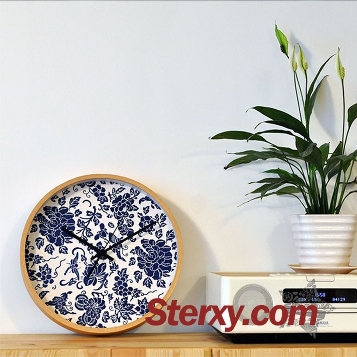 Made of a blend ramie cotton fabric, the clock dial is composed of butterflieswith blooming penoy flower motifs. Simple yet elegant, this wall clock can decorate your bare wall as wall art. #wallclock #blueandwhiteporcelain #art
