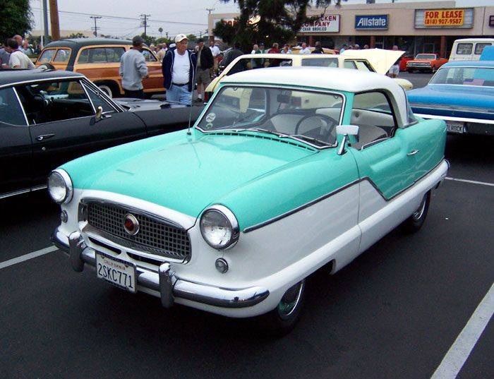 I WISH I owned a Nash Metropolitan.  It is the cutest ride ever.  If Droopy Dog was a car, he'd be this one!