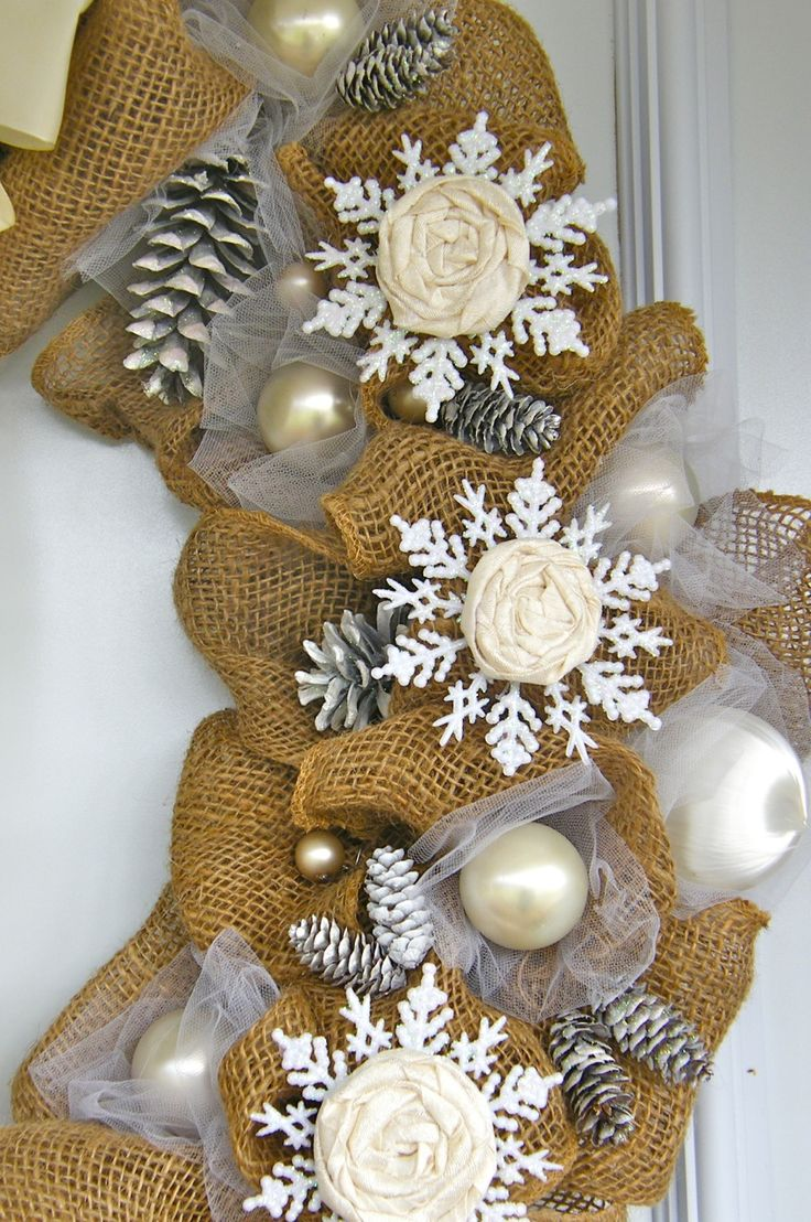 burlap wreath decorated with silk and snowflakes