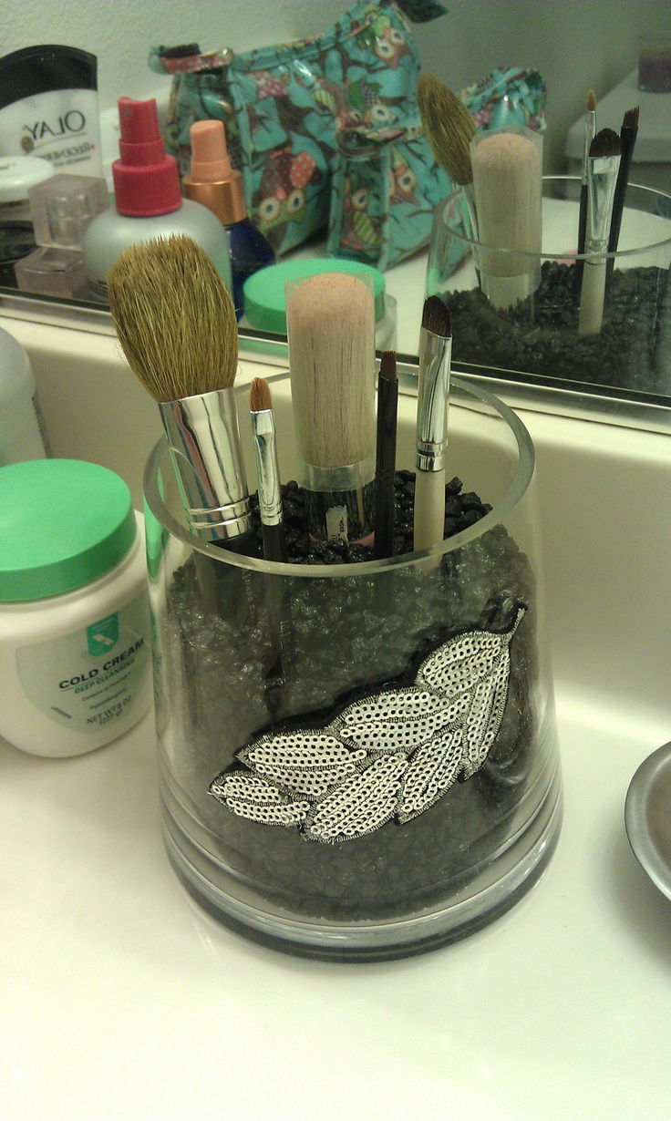 Cheap glass  and embellishment from Michael's and super cheap fish tank stones. Make up brush holder :)