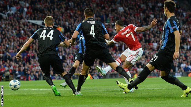 Memphis Depay scored twice to inspire Manchester United to victory over Club Brugge in their Champions League play-off.  Brugge took a surprise first-leg lead through Michael Carrick's own goal.  But Depay drove in a low strike and brilliantly cut inside and curled in a 25-yard shot to put United ahead.  Brugge defender Brandon Mechele was sent off for two bookings after 80 minutes and Depay crossed for Marouane Fellaini to head in a late third.  The home side looked set to be frustrated in…