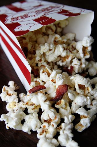 Fresh popcorn popped in BACON GREASE drizzled w/butter & sprinkled w/crumbled bacon & parmesan... Good Lord!