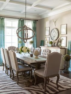 Dining room w gray walls. Farmhouse table, tufted upholstered chairs. Orb sphere light.