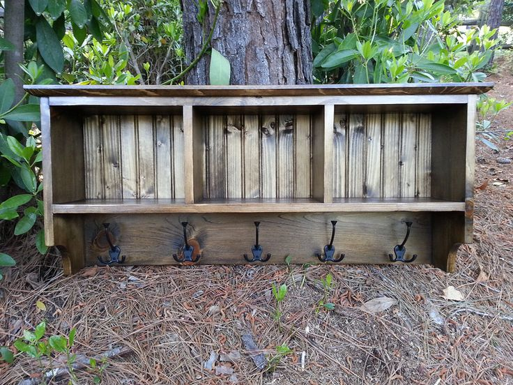 Rustic Coat Rack with storage cubbies for baskets. Solid wood with bead board backing and large triple hooks.