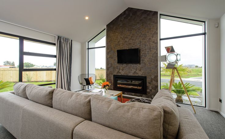 Living room fireplace feature. Mosaic stone look wall and glass materials are showcased!