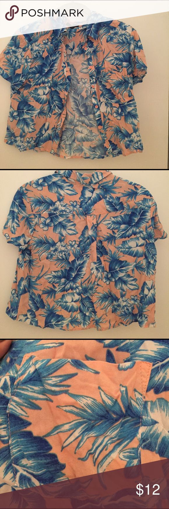 Tropical button-up crop top This crop top is so cute with button up closure. It is light pink with blue banana leaf/palm tree leaf design. It's a size small and fits like a crop top. Has been used but is very clean/washed, just some slight wrinkling. Nothing a little ironing can't fix! Unfortunately I don't own an iron so I can't do it myself. It has a front pocket and cute pink buttons. Perfect for this upcoming spring/summer! timing Tops Crop Tops
