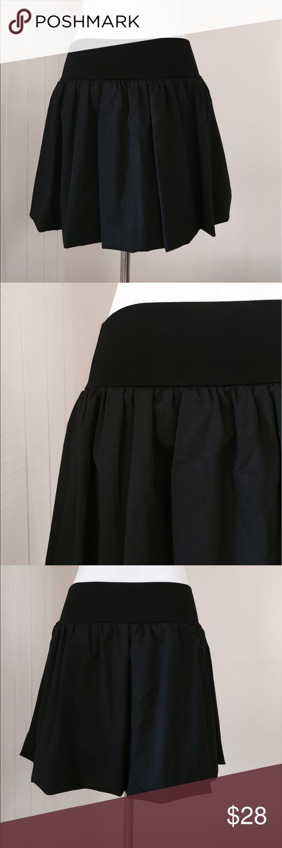 "Alice + Olivia Black wool  Silk Bubble Mini Skirt Beautiful and elegant Alice + Oliva black bubble skirt * Elasticated Waist * 98% Virgin Wool / 2% Lycra Exterior * 95% Silk / 5% Lycra Lining * 13"" Waist (can expand) * 15"" Length Alice + Olivia Skirts Mini"