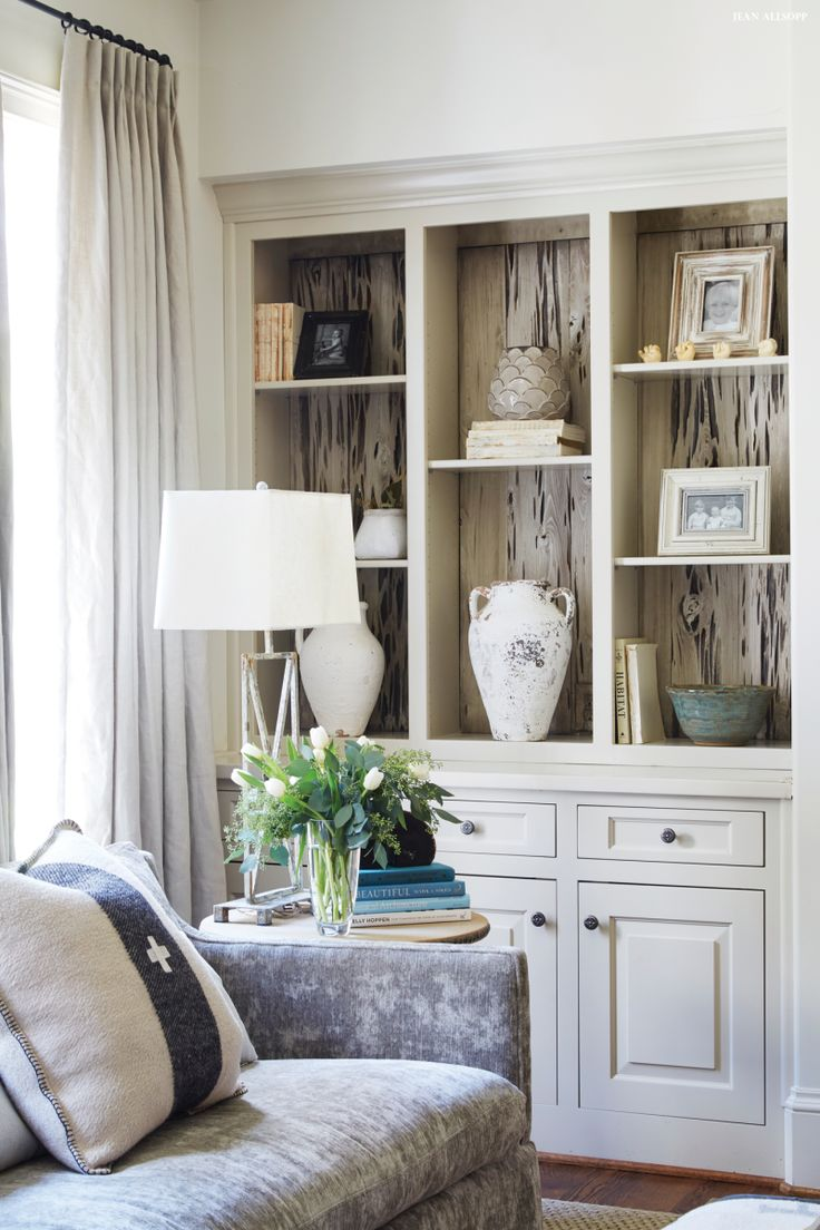 Built-in bookcases with pecky cypress back.