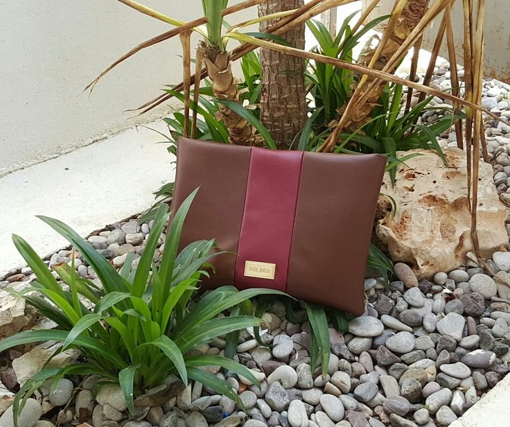 Good design is sustainable design. Featuring the brown-burgundy http://clutch.Shop  at http://vilmaboutique.com .