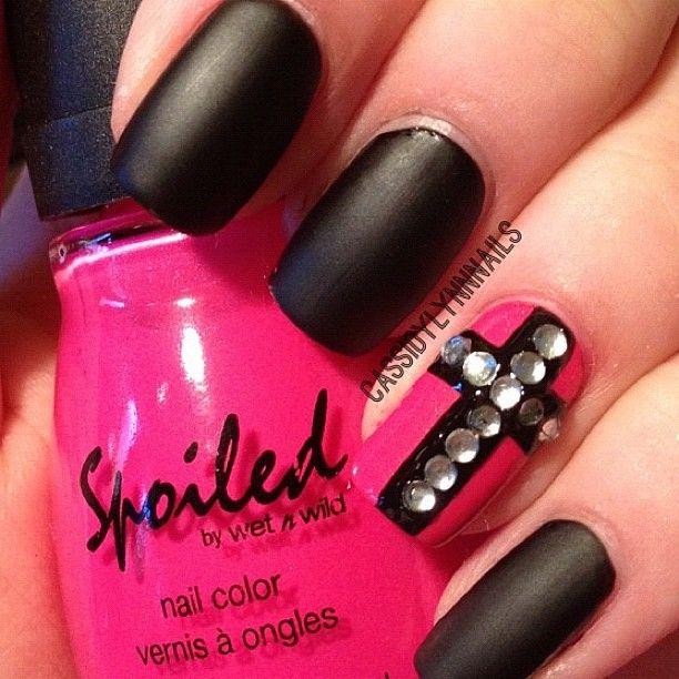 Matte black with single hot pink nail w. crystal cross @thenailartstory (NAIL ART) | Statigram