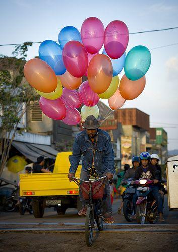 Cyclist with balloons, Surabaya, Java, Indonesia
