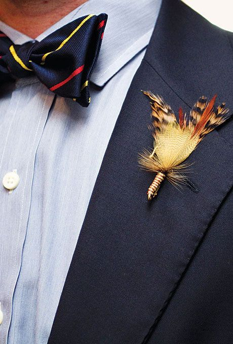 Brides: DIY Feather Boutonniere. An unexpected feather boutonniere comprised of fly-fishing materials the groom fastened himself.