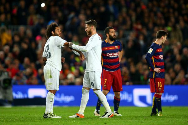 Sergio Ramos of Real Madrid CF passes the captain's armband to Marcelo of Real Madrid CF after receiving a red card during the La Liga match between FC Barcelona and Real Madrid CF at Camp Nou on April 2, 2016 in Barcelona