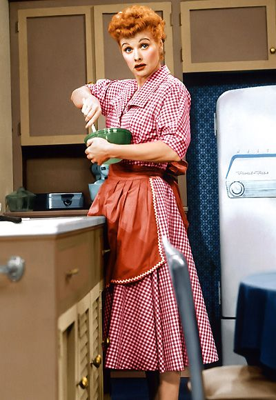 Lucy Ricardo, I Love Lucy  SIGNATURE STYLE:   Lucille Ball played down her natural glamour, opting instead for a kooky, lovable dizziness and a wardrobe filled with patterned shirtdresses.