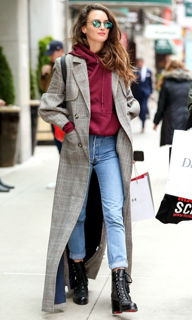 Charlotte Le Bon in a burgundy sweatshirt, jeans, long coat and booties - click through for more spring outfit ideas