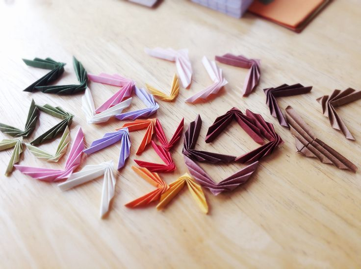 Some of today's folding efforts here at Erigami Design... Soon to be turned into earrings!  Facebook.com/erigamijewellery